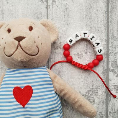 Červený náramok proti urieknutiu a na žužlanie pre deti s menom (2v1)