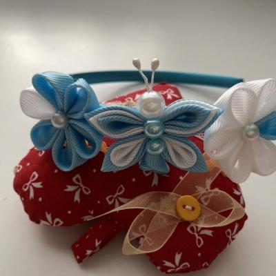 Čelenka malý motýlik- svetlo modrá
