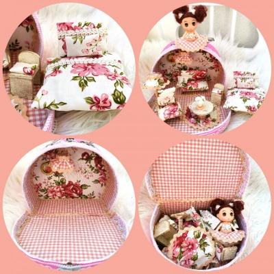 Okrúhly ružový ňuňu kufrík