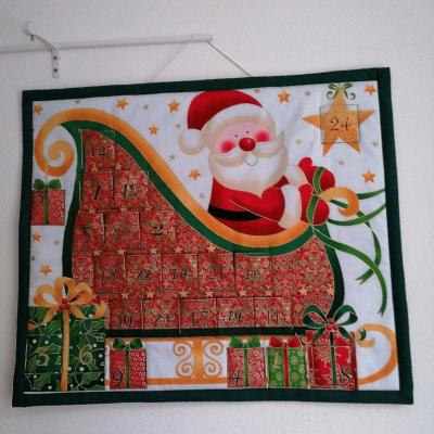 Adventný kalendár Santa na saniach