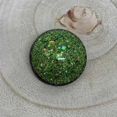 Zelená okrúhla brošňa
