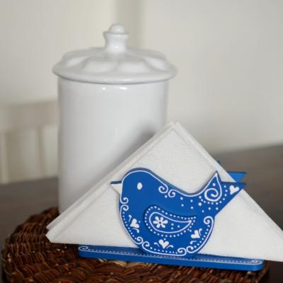 Modrý stojan na servítky vtáčik