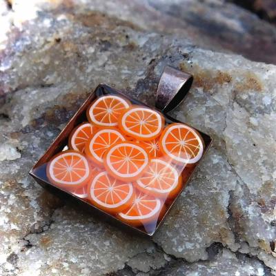 prívesok pomaranče v medi